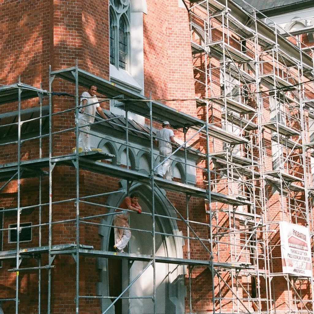 workers on scaffolding - rc associates